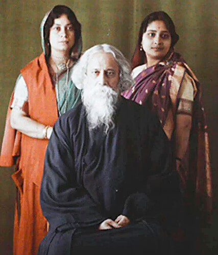 A-rare-color-photo-of-Rabindranath-Tagore---with-daughter-Bela-to-his-left-and-daughter-in-law-Pratima-to-his-right.