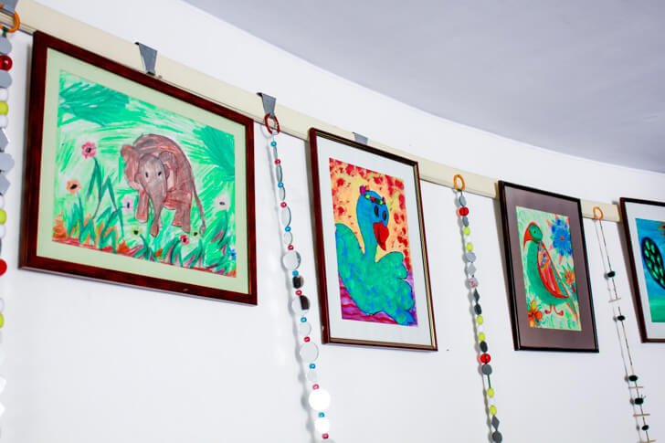 Artwork by Disha kids displayed in the reception